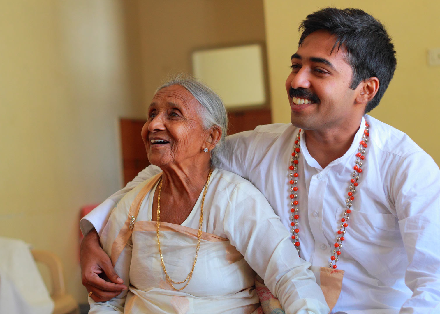 A wedding morning scene with the groom and his grandmother