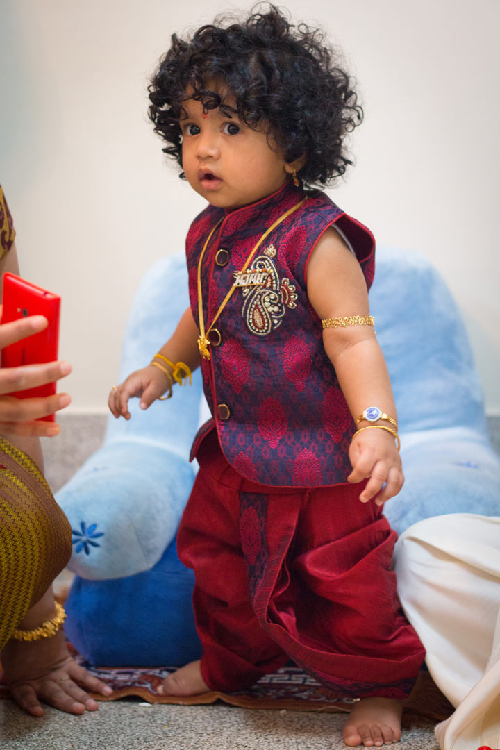 a portrait of baby Ajay standing