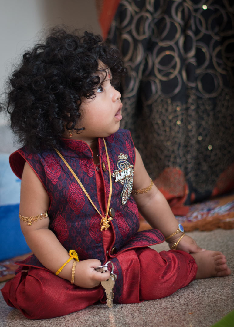 a portrait of baby Ajay sitting