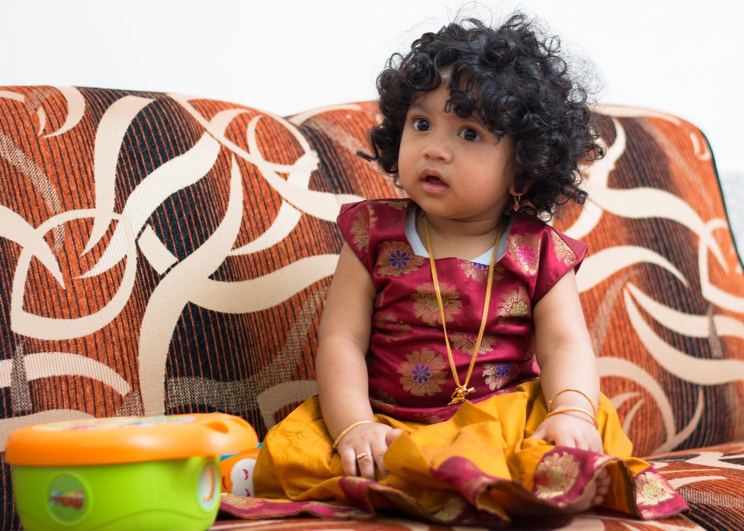 toddler Ajay sitting