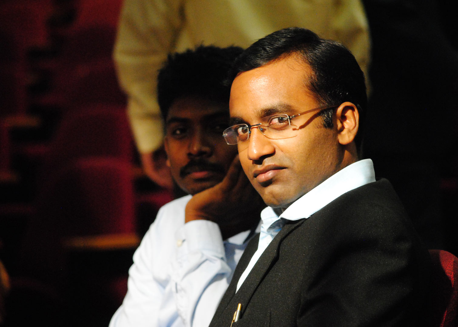 Dr. Deepak Rangaswamy seated