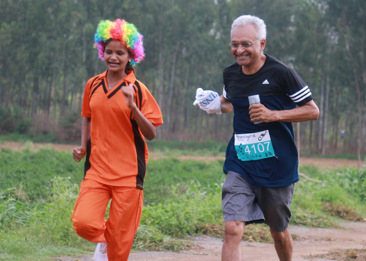 An old man being cheered by a young girl to run